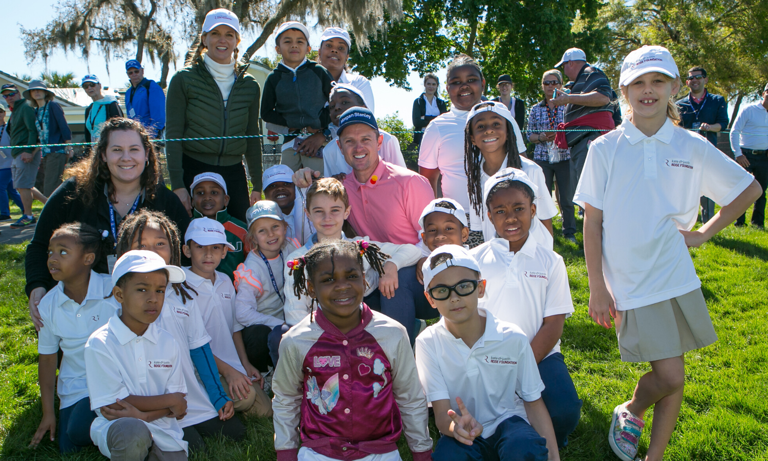 Photo of Kate and Justin Rose with the kids on the golf course